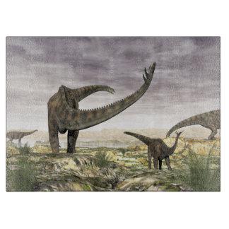 Planche À Découper Troupeau de dinosaures de Spinophorosaurus dans le