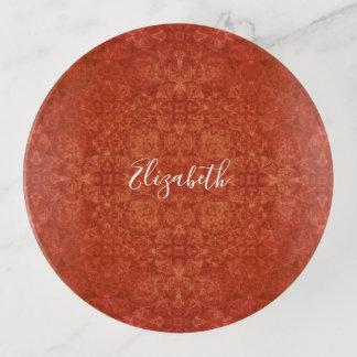 plateau rouge terreux de bibelot de motif de