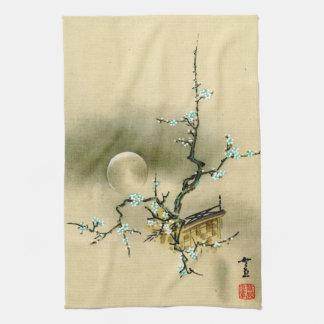 Pleine lune au-dessus de la branche se développant serviettes éponge