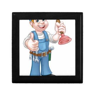 Plombier de bricoleur de bande dessinée tenant le petite boîte à bijoux carrée