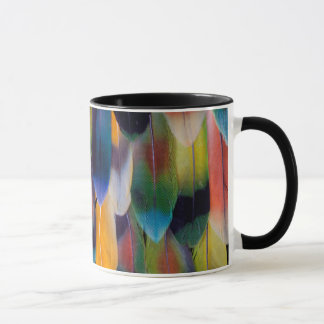 Plumes colorées de perroquet de perruche mugs