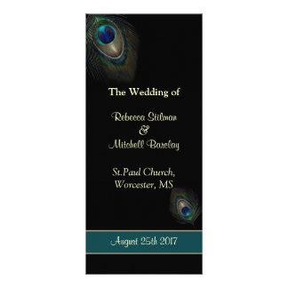 Plumes de paon sur le programme noir de mariage