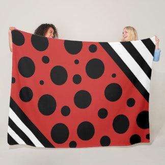 Pois noir et couverture rouges et blancs de
