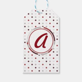Pois rouge et étiquettes bronzages de cadeau de