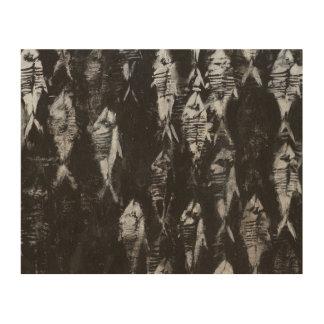 Poissons blancs fossiles sur l'arrière - plan noir canevas en bois