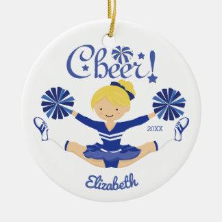 Pom-pom girl blond d'acclamation bleue mignonne ornement rond en céramique