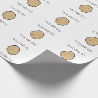 Pommes de terre allant au papier d'emballage de papiers cadeaux noël