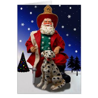 Pompier Père Noël avec la carte de vacances de