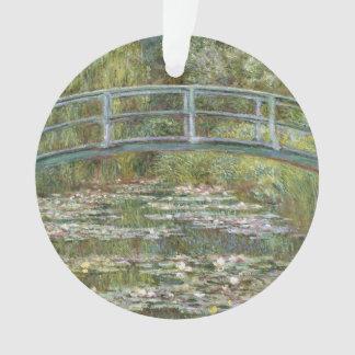 Pont au-dessus d'un étang des nénuphars par Claude
