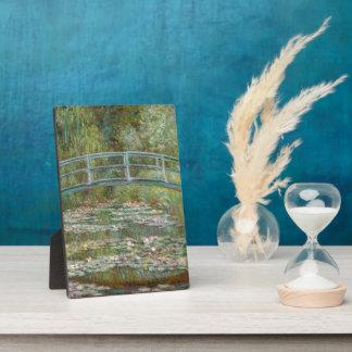 Pont d'art de Monet au-dessus d'un étang des Impression Sur Plaque
