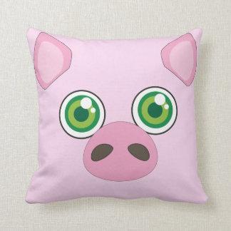 Porc mignon avec le coussin de rose de yeux verts