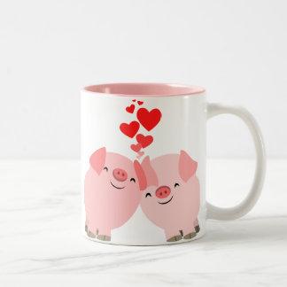 Porcs mignons de bande dessinée dans la tasse d'am