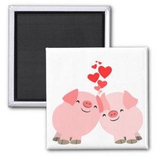 Porcs mignons de bande dessinée dans l'aimant d'am