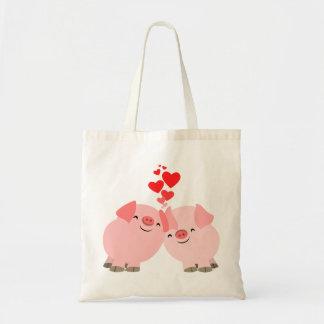 Porcs mignons de bande dessinée dans le sac d'amou