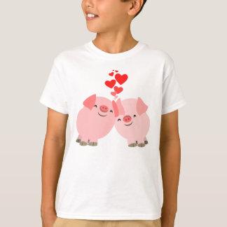 Porcs mignons de bande dessinée dans le T-shirt