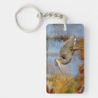 Porte-clefs Héron de grand bleu encadré avec le feuillage