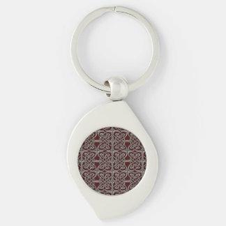 Porte-clés Argent et motif celtique d'ovales relié par rouge