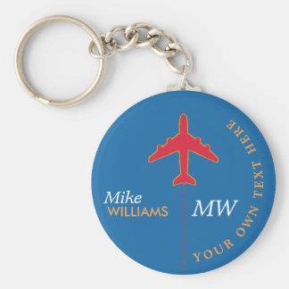 Porte-clés avion rouge sur le porte - clé bleu avec le nom