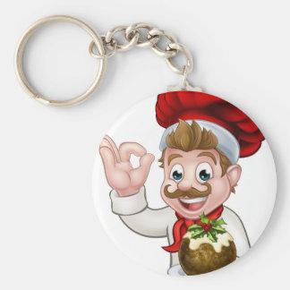 Porte-clés Chef dans le casquette de Noël tenant le pudding