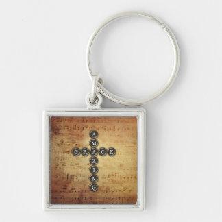 Porte-clés Croix extraordinaire de grâce sur la feuille de