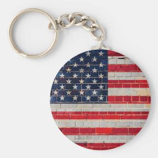 Porte-clés Drapeau de l'Amérique sur un mur de briques