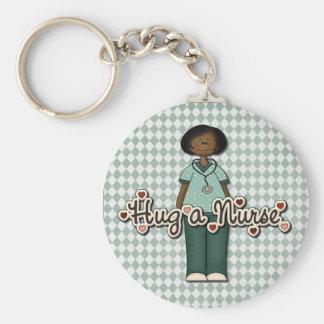 Porte-clés Étreignez une infirmière de sourire amicale