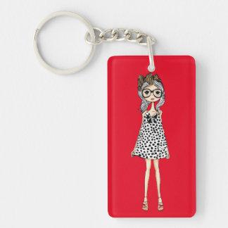 Porte-clés Fille maladroite mignonne dans sa robe de point de