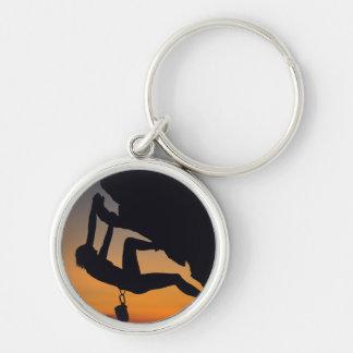 Porte-clés Grimpeur de roche accrochant au lever de soleil