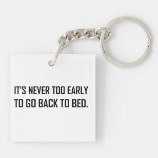 Porte-clés Jamais à tôt de nouveau au lit