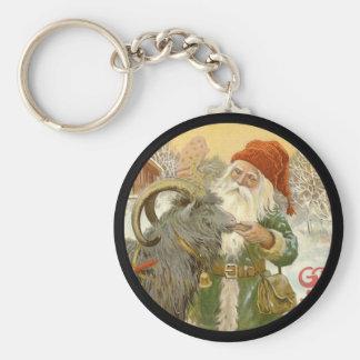 Porte-clés Jultomten alimente à chèvre de Noël un biscuit