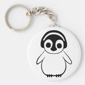 Porte-clés Le pingouin écoute l'insigne de musique