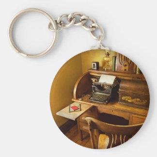 Porte-clés Le travail - dactylo - une personne avec beaucoup