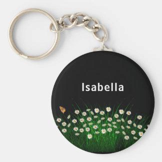 Porte-clés Les marguerites blanches fleurissent le pré et le