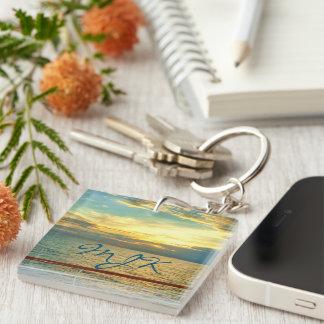 Porte-clés Lever de soleil marin décoré d'un monogramme