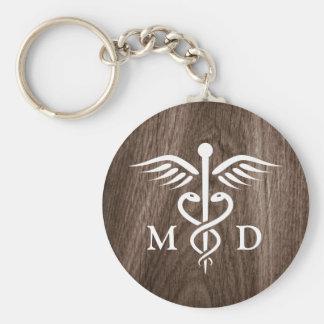 Porte-clés Médecin de DM avec le caducée sur l'arrière - plan
