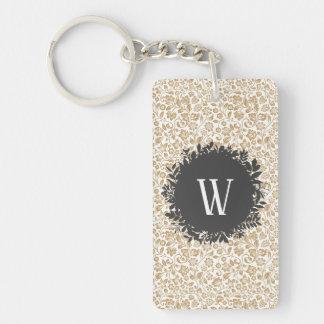 Porte-clés Motif floral d'or avec le monogramme gris-foncé de
