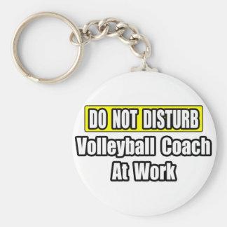 Porte-clés Ne dérangez pas… l'entraîneur de volleyball au tra