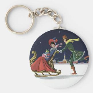 Porte-clés Noël vintage, couple dans le patinage de glace