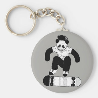 Porte-clés Panda faisant de la planche à roulettes