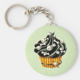 Porte-clés Petit gâteau noir de Halloween avec les crânes