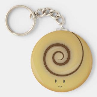 Porte-clés Petit pain de cannelle de sourire au-dessus de