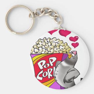 Porte-clés Pigeon dans l'amour avec une boîte de maïs éclaté