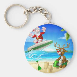 Porte-clés Surfer et renne de Père Noël sur la plage
