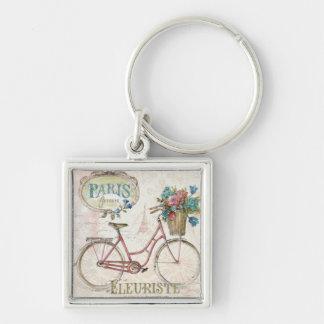 Porte-clés Vélo de Paris avec des fleurs dans l'avant