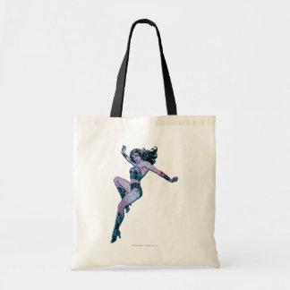 Pose colorée de femme de merveille sac fourre-tout