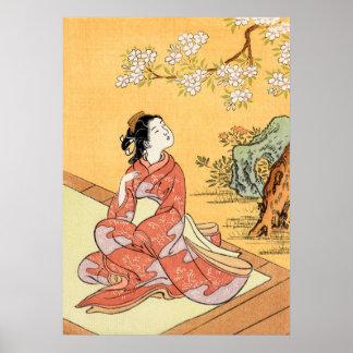 Poster Femme s'asseyant sous des fleurs de cerisier