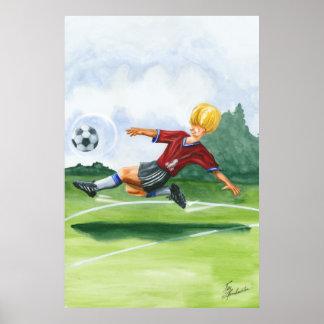Poster Footballeur donnant un coup de pied une boule par