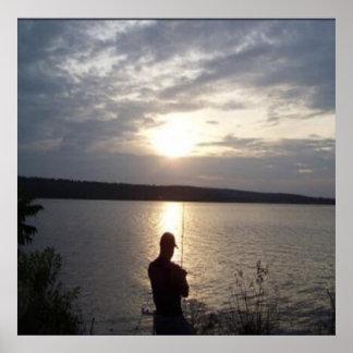 Poster Silhouette de la pêche de l'homme au coucher du