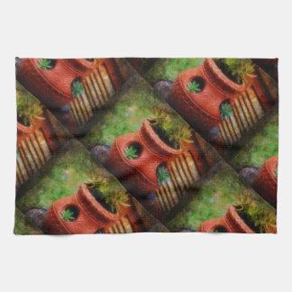 Pot de couverture colorée par terre de plantes linge de cuisine