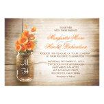 Pot de maçon et fleurs oranges épousant des invita